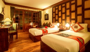 全室バルコニー付きの落ち着いた雰囲気の客室